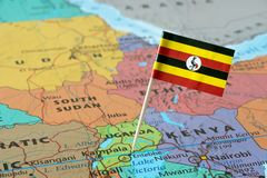 Uganda flag on a map. Uganda paper flag pin on a map. Republic of Uganda is a landlocked country in East Africa stock image