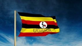 Uganda flag slider style with title. Waving in the. Uganda flag slider style with title. Waving with cloud background animation stock footage