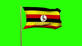 Uganda flag with title waving in the wind. Looping stock video footage