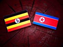 Uganda flaga z koreańczyk z korei północnej flaga na drzewnym fiszorku Zdjęcia Stock