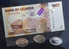 Uganda-Geld, -münzen und -rechnungen lizenzfreie stockbilder