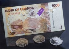Uganda money, coins and bills. Black background royalty free stock images