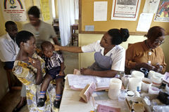 Ugandan AIDS hospital TASO Kampala. Uganda, district capital city Kampala: in this clinic for AIDS patients a nurse comforting a young boy who is HIV positive Stock Image
