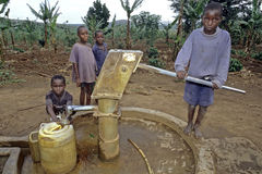 Ugandan Children Fetch Water At Water Pump Stock Photography