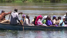 Ugandan people in the boat stock video