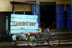 Ugandan Tearoom and Shop. A tearoom and shop in the Ugandan village of Kisoro with a 'taxi' bicycle waiting outside Stock Photo