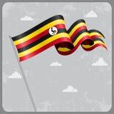 Ugandan wavy flag. Vector illustration. Royalty Free Stock Photography
