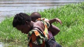 Ugandan woman with baby stock video footage
