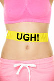 UGH my stomach hurts concept - girl belly problems. UGH my stomach hurts concept - girl with belly problems. Word written on yellow sign on female lower body to Stock Images