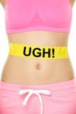 UGH verletzt mein Magen Konzept - Mädchenbauchprobleme Stockbilder