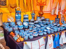 Uglich, Russia - 20 July 2017: Russian wooden utensils. Painted in Vologda Khokhloma style. Traditional Russian souvenir Stock Photography