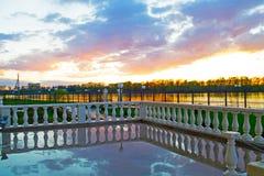 Uglich, Russia - may, 04, 2016: a beautiful sunset reflected in the rain water. Russia, Uglich: a beautiful sunset reflected in the rain water drenched terrace Stock Image