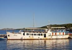 Uglijan island, Croatia - abandoned rusty cruising ship at pier Royalty Free Stock Image