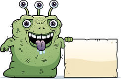 Ugly Alien Sign. A cartoon illustration of an ugly alien with a sign Royalty Free Stock Photo