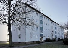 Ugly big apartment block from the seventies in a suburb with che. Ap rental apartments, Wolfsburg, Germany Stock Photos