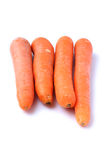Ugly Carrots on a White Background. Four ugly carrots isolated on a white background Stock Photo