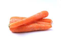 Ugly Carrots on a White Background 3. Four ugly carrots isolated on a white background Royalty Free Stock Images