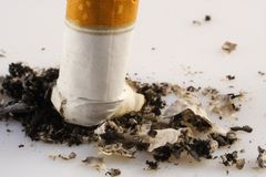 Ugly cigarette ash. Stop smoking message by showing a close up cigarette ash details Royalty Free Stock Photos