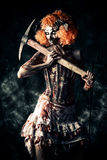 Ugly clown. Evil clown murderer stained in blood. Female zombie clown. Halloween. Horror stock photos