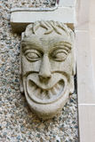 Ugly gargoyle. Grinning and showing his teeth Royalty Free Stock Image