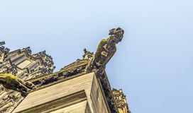 Ugly gargoyle sculpture at the dome Royalty Free Stock Photos