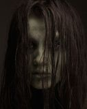 Ugly horror girl. Close up portrait of a demon. Zombie make up, spooky, ugly horror girl royalty free stock images