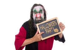 Ugly mad clown holding a slate, text Halloween party, isolated o Royalty Free Stock Image