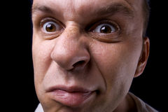 Ugly man. Ugly and angry man on black background Royalty Free Stock Photography