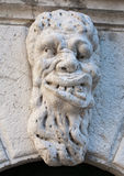 Ugly man bas-relief stone face Stock Image