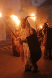 Ugly Masks With Torches Stock Photography