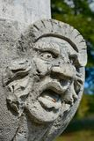 Ugly stone face sculpture Royalty Free Stock Photography