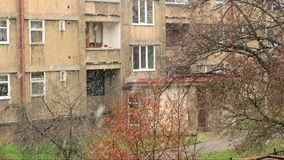 Ugly Urban City Snowfall, Back Focused. A detailed view of urban building while city sees first snow flakes stock footage