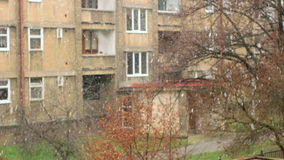 Ugly Urban City Snowfall, Front Focused. First snow flakes falling down from the sky in Prague stock video footage