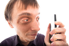 Ugly weirdo man looking at cellphone. Isolated on white background Stock Photo