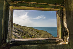 Ugly window and beautiful seaview. Royalty Free Stock Photo