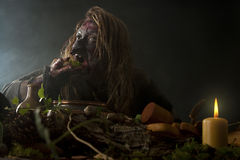 Ugly Witch is eating weed stock photography