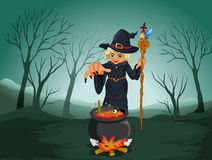 An ugly witch holding a cane Stock Images