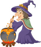 The ugly witch is stirring the protion Stock Images