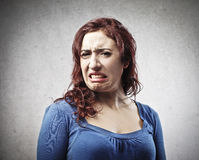 Ugly Woman. Woman disgusted by someone or something Royalty Free Stock Image