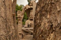 Ugra Narsimha or Lakshmi Narsimha captured through windows at Hampi. The man-lion avatar of Lord Vishnu - seated in a. Yoga position royalty free stock image