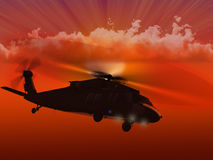 UH-60 Blackhawk flying sunset Stock Photo