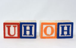 Uh-Oh. Oops apology spelled out with toy blocks Royalty Free Stock Images