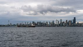 Time lapse of stormy sky over Seattle WA city skyline from Alki Beach 4k UHD. UHD 4k time lapse movie of moving clouds and sky over urban scenic view of downtown stock video footage