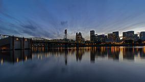 UHD 4k Timelapse of Clouds and Sunset into Blue Hour over City Skyline and Hawthorne Bridge in Portland Oregon 4096x2304. UHD 4k Timelapse Movie of Moving Clouds stock video footage