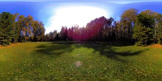 UHD 4K 360 VR Virtual Reality of a city park recreation area. Trees and green grass at autumn or summer day. Path and sun rays. Original sound stock video