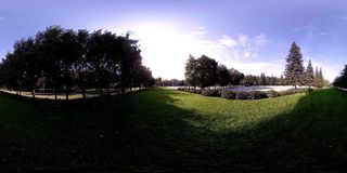 UHD 4K 360 VR virtual reality of a city park recreation area. Trees and green grass at autumn or summer day stock video footage