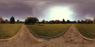 UHD 4K 360 VR Virtual Reality of a city park recreation area. Trees and green grass at autumn or summer day. Path and sun rays. Original sound stock video footage