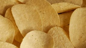 UHD macro of potatoe chips. UHD of classic potatoe chips on the rotating stand stock footage