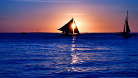 UHD of sailboats cruising at sunset time. Silhouettes of cruising sailboats at dusk in UHD stock video