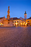 Uherske Hradiste, Czech Republic. Monument and the town hall tower in a square of the old town of Uherske Hradiste early in the morning Royalty Free Stock Images